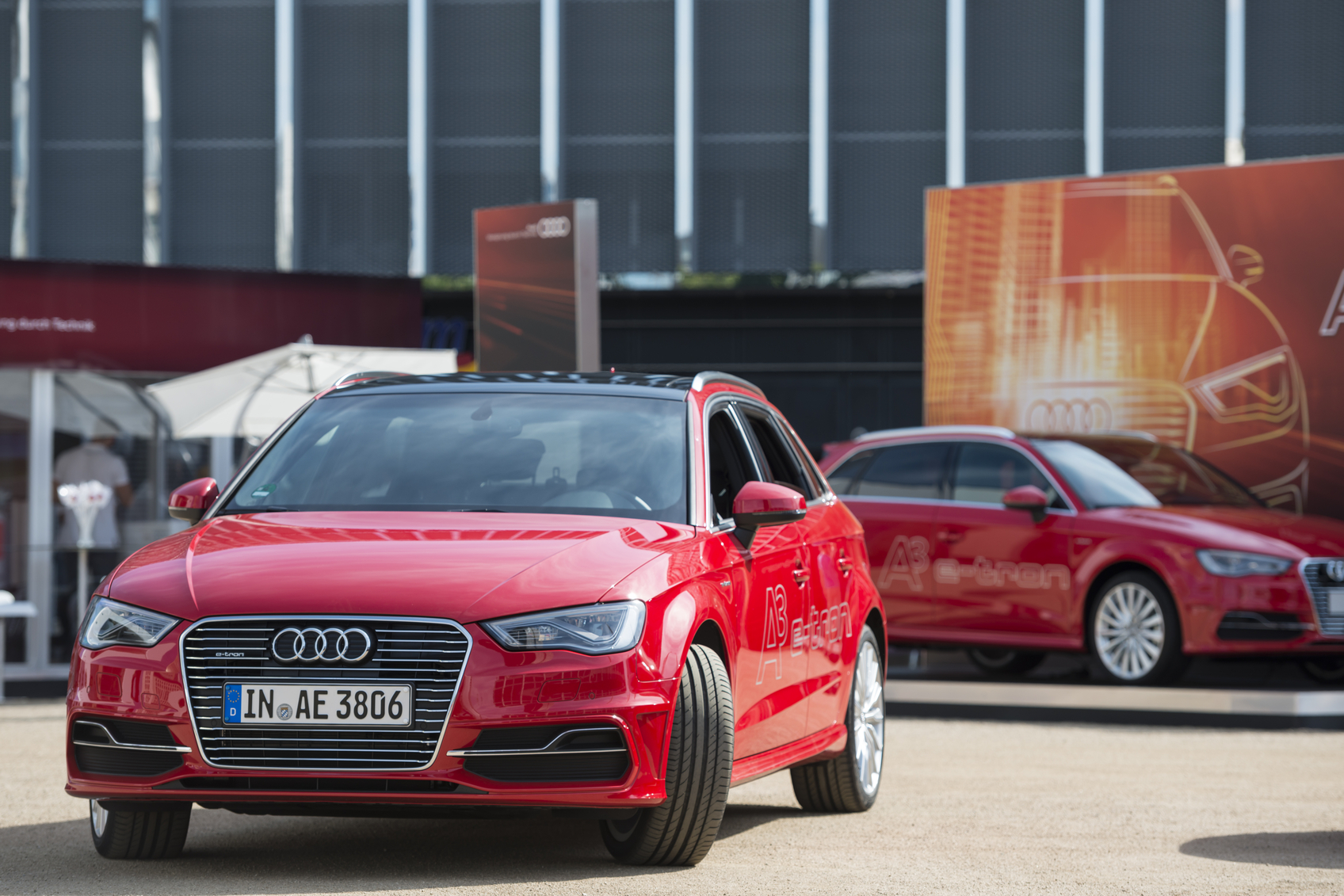 Frankfurt am Main, Germany- July 18, 2014: Audi A3 e-tron at a public displayed in a public ground near a shopping mall. This car is a Hybrid car, based on the AUDI A3 and will be launched in 2015. Audi AG is a German manufacturer of automobiles, the company is headquartered in Ingolstadt, Germany, and is a wholly owned subsidiary of Volkswagen AG. In the background two spectators can be seen.