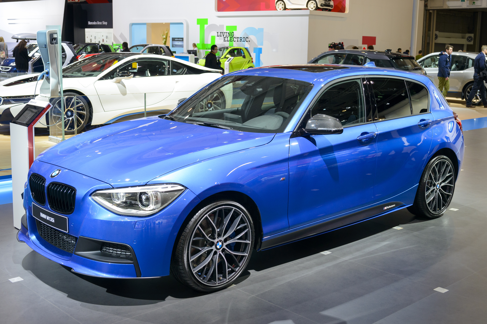 Brussels, Belgium - January 14, 2014: BMW 1-series M135i compact hatchback car on display at the 2014 Brussels motor show. People in the background are looking at the cars.