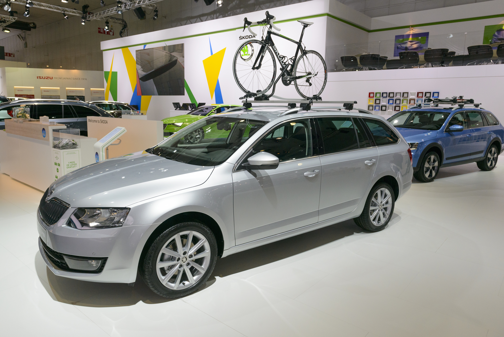 Brussels, Belgium - January 15, 2015:  Skoda Octavia Combi station wagon on display during the 2015 Brussels motor show. People in the background are looking at the cars.