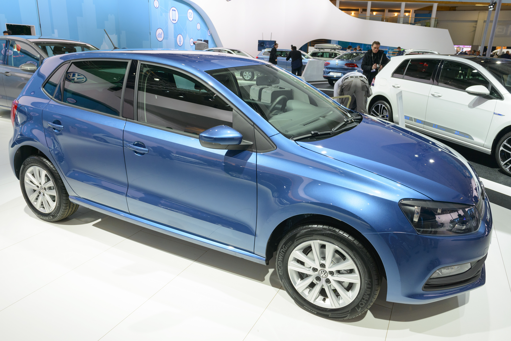 Brussels, Belgium - January 15, 2015: Volkswagen Polo hatchback car on display during the 2015 Brussels motor show. People in the background are looking at the cars.